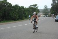 Tracy racing the bike at Port HIM
